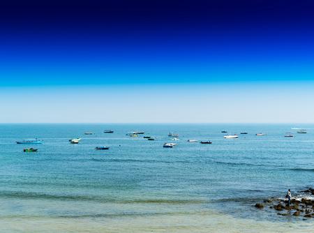Horizontal vivid indian boats in ocean horizon background