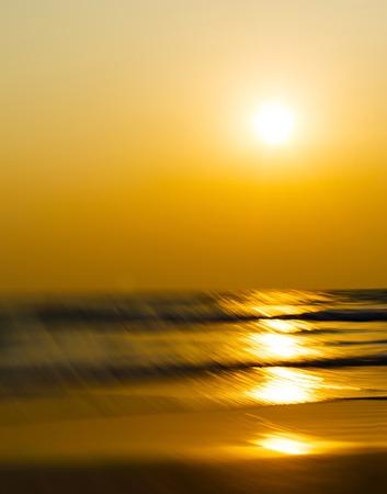 slow motion: Vertical vivid orange sunset motion blur abstraction background backdrop Stock Photo