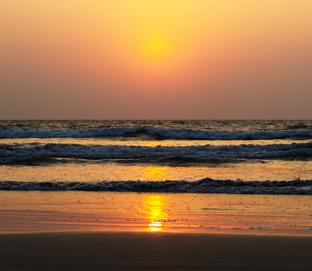 Horizontal vivid ocean sunset tidal waves background backdrop Stock Photo