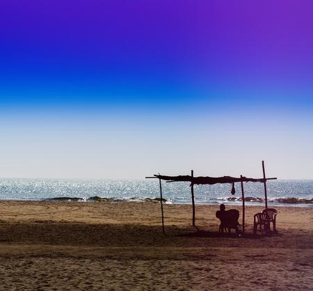 and the horizontal man: Horizontal vivid man meeting ocean sunset under awning background backdrop Stock Photo