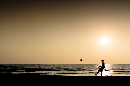 and the horizontal man: Young man playing football silhouette on horizon sunset horizontal illustration