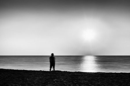 and the horizontal man: Horizontal vivid black and white sunset with a lonely man abstraction landscape background backdrop