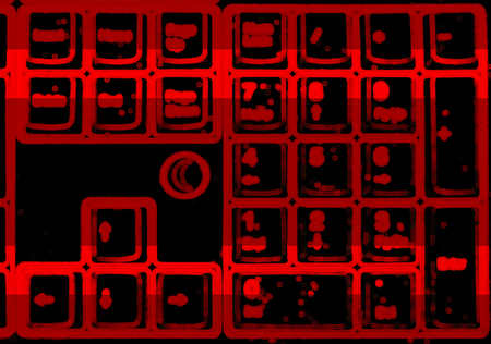 terminator: Horizontal red blurred interlaced keyboard background Stock Photo
