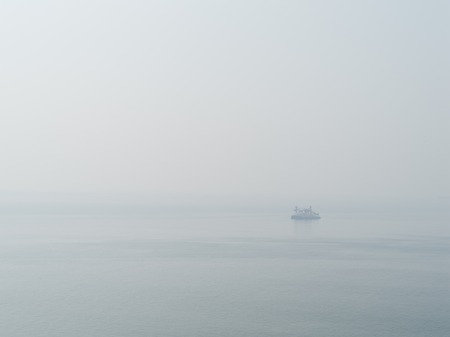 sparse: Horizontal sparse pale lonely ship in white ocean background backdrop