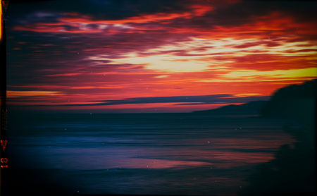 Horizontal vintage red orange vibrant sunset ocean horizon motion abstraction film scan background backdrop