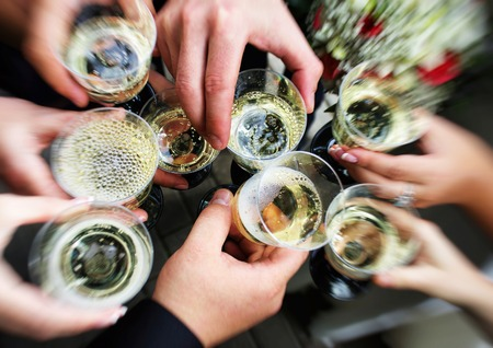 clink: Massive clink glasses celebration Stock Photo