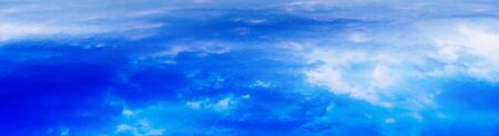 dramatic clouds: Horizontal wide panorama blue vivid above cloudscape background backdrop Stock Photo