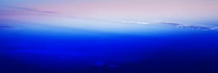 stratosphere: Horizontal wide blue vivid minimal clouds stratosphere background backdrop