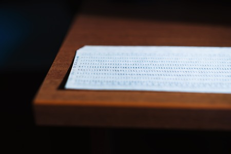 punched: Horizontal punched card bokeh background Stock Photo