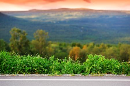grass border: Horizontal mountain road with grass border background hd Stock Photo