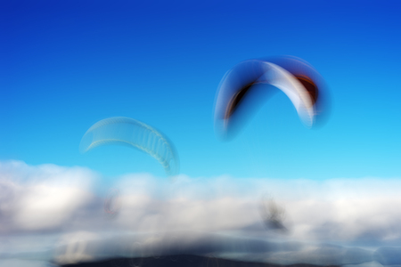 flying kites: Couple of flyers with flying kites bokeh background hd Stock Photo