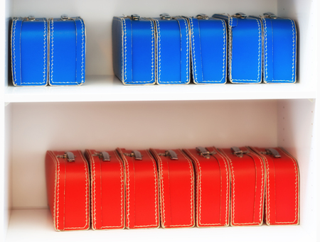 the case selected: Blue and red toy cases on the shelf background hd