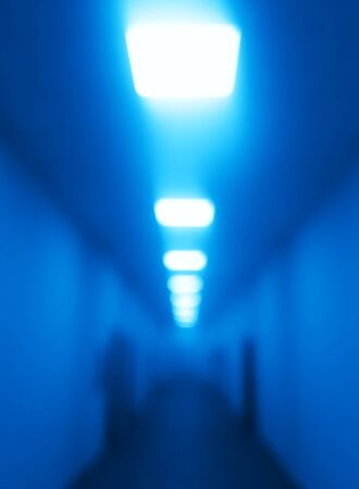 Blue office corridor with illumination bokeh background