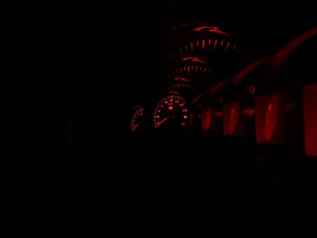 Inside sport car red speedometer in motion backdrop