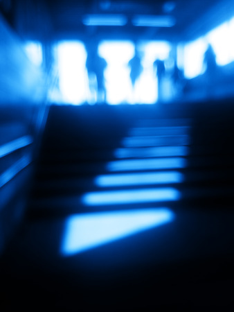 diagonal: Diagonal blue metro station stairs bokeh background