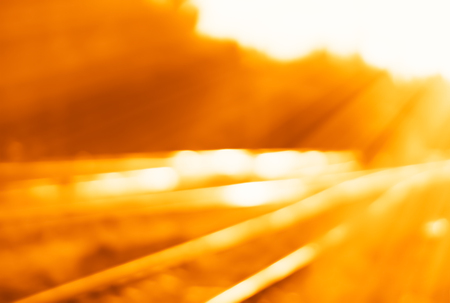Diagonal railroad bokeh with light leak background Stock Photo