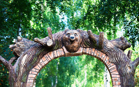 Park arc gate with bear head background Stock Photo