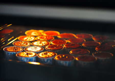 Cooking cupcakes in oven backdrop hd Stock Photo