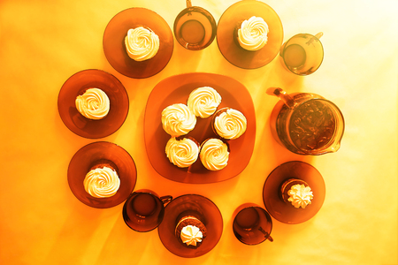 Decorated table with fresh cupcakes warm background hd
