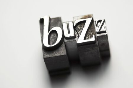 The word buzz photographed using old letterpress type.  Stock Photo