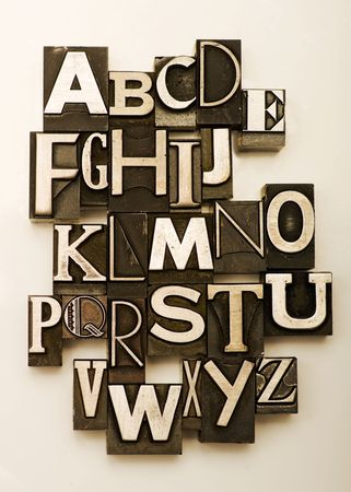 c r t: Alphabet photographed using a mix of vintage letterpress characters. Cross-proccessed for a vintage look.