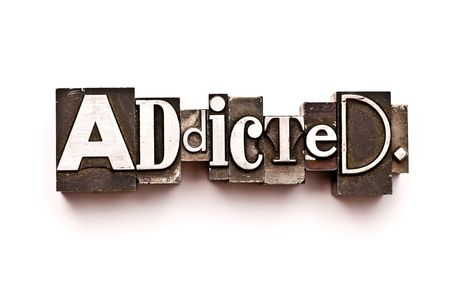 The word Addicted photographed using vintage letterpress type Stock Photo