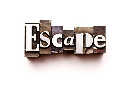 The word Escape photographed using vintage letterpress type Stock Photo - 3593498