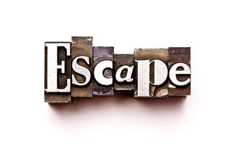 The word Escape photographed using vintage letterpress type
