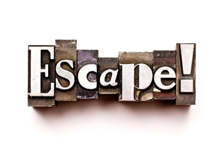 The word Escape photographed using vintage letterpress type Stock Photo - 3593514