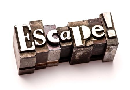 The word Escape photographed using vintage letterpress type Stock Photo - 3593502