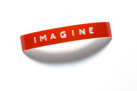 The word Imagine done with old-fashioned punch-style lettering