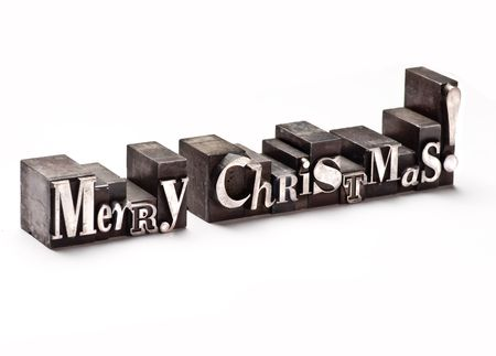 The phrase Merry Christmas in letterpress type