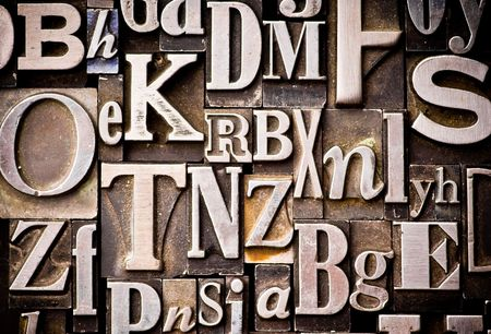 A randon arrangement of letterpress letters. Part of a series of letterpress backgrounds 版權商用圖片