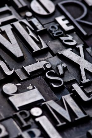 A random arrangement of letterpress letters with narrow depth of field. Part of a series of letterpress backgrounds