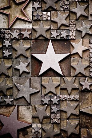 five pointed: A random arrangement of letterpress stars with narrow depth of field. Part of a series of letterpress backgrounds Stock Photo