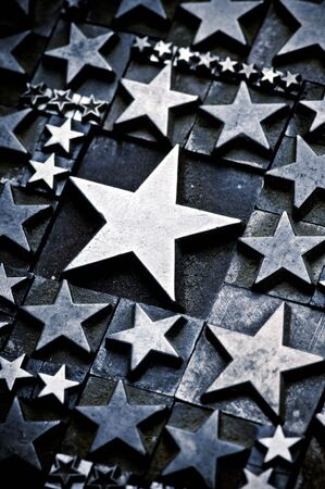 A random arrangement of letterpress stars with narrow depth of field. Part of a series of letterpress backgrounds Stock Photo