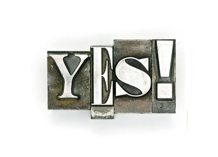 The word Yes photographed with letterpress type