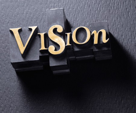 The word Vision in Letterpress Type
