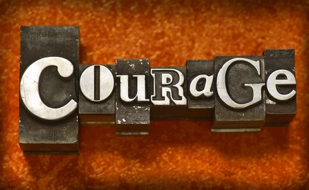 The word Courage in letterpress type