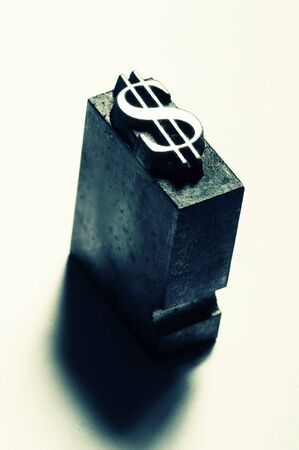 The symbol for the dollar done in old lead type. Cross-processed for a unique look. Stock Photo