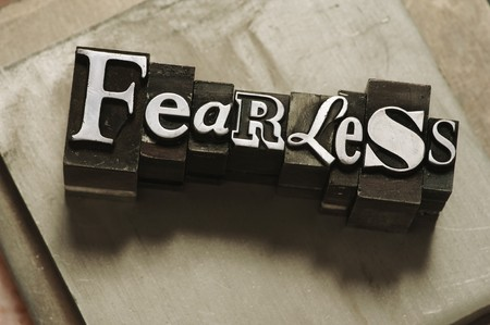 defiant: The word Fearless in letterpress type