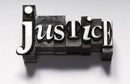 fair trial: The word Justice in letterpress type Stock Photo