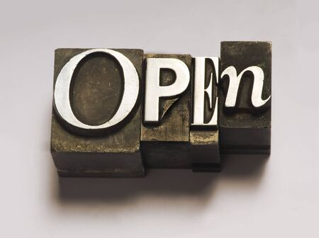The word Open in letterpress type