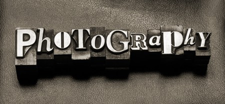 The word Photography in letterpress type