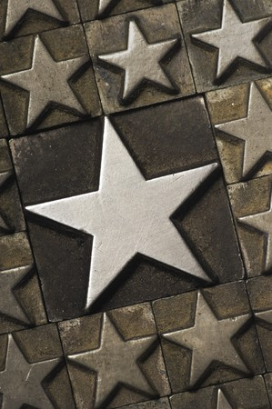 five star: Large Star surrounded by smaller ones. Photographed using letterpress characters. Stock Photo