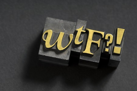 wtf: The acronym WTF done in old lead type.