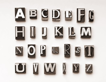 Alphabet photographed using a mix of vintage letterpress characters. Cross-proccessed for a vintage look.