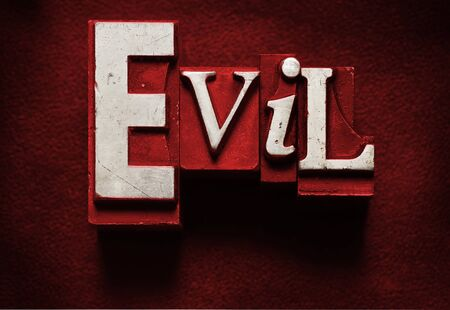 The word Evil done in letterpress type Imagens