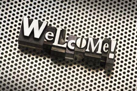 letterpress  type: The word Welcome done in letterpress type