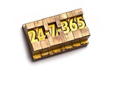 The phrase 24-7-365 done in vintage letterpress type Stock Photo - 4065963
